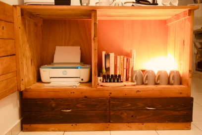 Printer + Self improvement library. A salt lamp and some essential oils for vibes.